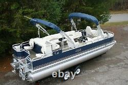 Last one in stock-New 24 two tube pontoon boat with 115 hp and trailer
