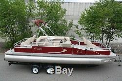 New 24 ft pontoon boat 60 hp and dual bunk trailer