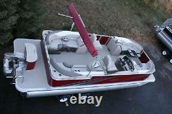 New 24 ft pontoon boat with 115 hp and trailer