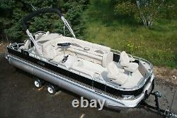 New 24 two tube pontoon boat with 115 hp and trailer