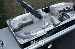 New 26 ft pontoon boat with 115 hp and trailer