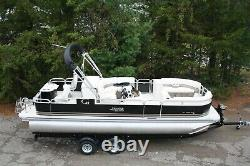 New two tube 23 ft pontoon boat with 60 hp and trailer