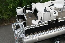 Order now. New 24 two tube pontoon boat with 115 hp and trailer
