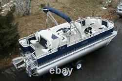 Triple tube New 20 fish and fun pontoon boat-150 four stroke and trailer