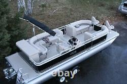 Triple tube New 2580 bf pontoon boat with 150 hp trailer