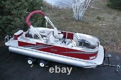 Two tube-New 24 ft pontoon boat with 115 hp and trailer
